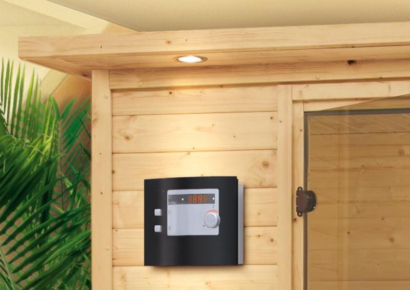 Woodfeeling 38 mm Massiv Sauna Yassin (Eckeinstieg) für niedrige Räume mit Dachkranz