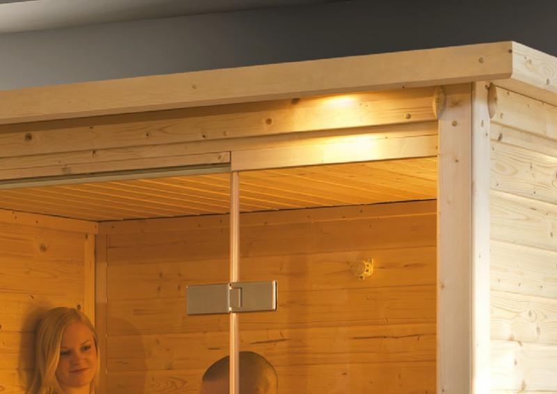 Woodfeeling 38 mm Massiv Sauna Svenja (Fronteinstieg) mit Dachkranz und Energiespartür